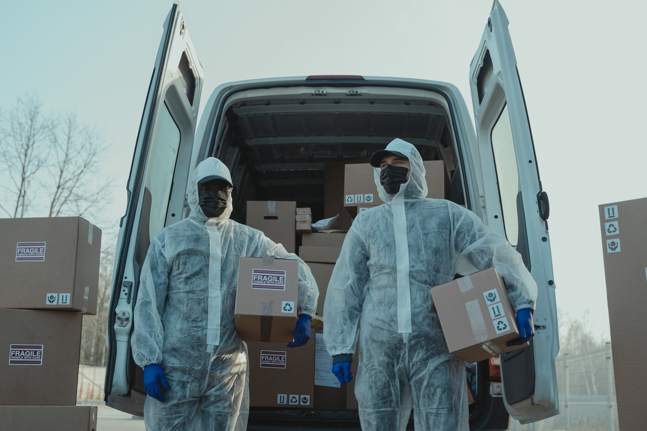 Image of car with unloaded goods. Provision of services and logi